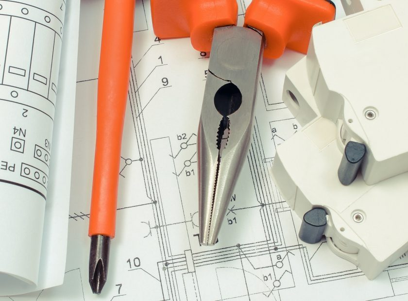 Electrical diagrams, electric fuse and work tools on construction drawing of house. Building home concept